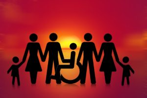 Graphic image of one person in a wheel chair along with other people standing