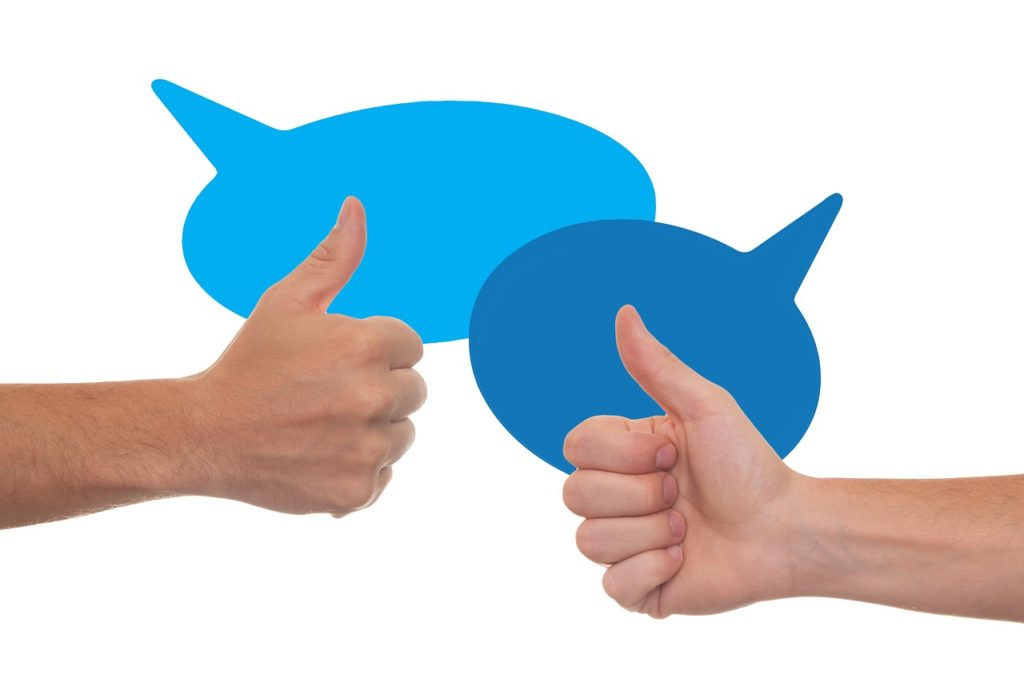 thumbs up with speech bubbles